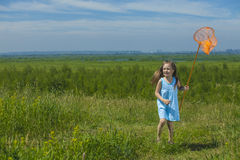Kids summer in the meadow with orange net Stock Image