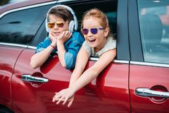 Kids in sunglasses on car trip looking out. Of window stock photos