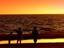 Kids at sunset. Kids playing in the surf at sunset in Florida Stock Images