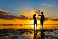 Kids at sunset Stock Image
