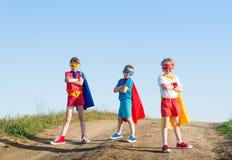 Kids superhero. Kids acting like a superhero royalty free stock images