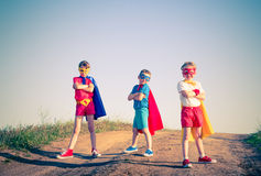 Kids superhero. Kids acting like a superhero retro vintage instagram filter Royalty Free Stock Photography