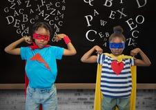 Kids in superhero costume flexing their arms against blackboard in background vector illustration