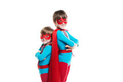 Kids superhero with a mask and cloak look at camera Isolated. Royalty Free Stock Photography