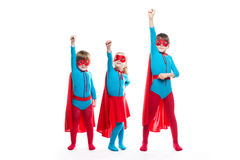 Kids superheroes. Idea. Kids superheroes. Boys and girl characters in costumes posing on white background. Idea royalty free stock photography
