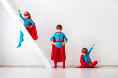 Kids superheroes. Kids superheroes on white background at home Royalty Free Stock Photos