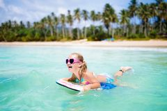 Kids surf on tropical beach. Vacation with child. Stock Photo