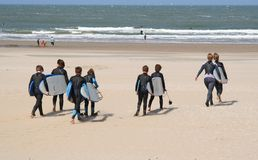 Kids with Surfboards. Kids with their teachers with surfboards heading for the surf. Picture taken on May 19, 2007 in Scheveningen, Holland Royalty Free Stock Images