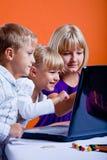 Kids surfing internet stock image