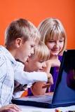 Kids surfing internet Stock Photos