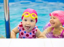 Kids  swim in pool Stock Photo