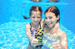 Kids swim in pool underwater Stock Images