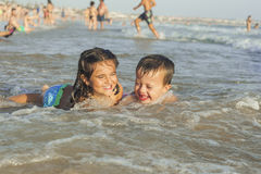 Kids swiming and playing in the seashore Royalty Free Stock Photo