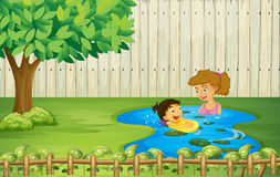 Kids swimming in a pond Stock Photos