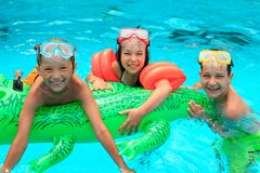Kids in swimming pool royalty free stock photo