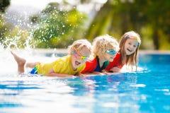 Kids in swimming pool. Children swim. Family fun