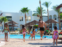 Kids at Swimming Pool. Egypt, Nov. 23 2014 : Happy people enjoying bath time in pool, Sharm el-Sheikh Stock Images