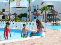 Kids at Swimming Pool. Egypt, Nov. 23 2014 : Happy people enjoying bath time in pool, Sharm el-Sheikh Stock Photography