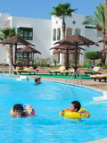 Kids at Swimming Pool. Egypt, Nov. 23 2014 : Happy people enjoying bath time in pool, Sharm el-Sheikh Royalty Free Stock Photo