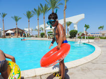 Kids at swimming Pool. Egypt, Nov. 23 2014 : Happy people and girls in bikini enjoying bath time in pool, Sharm el-Sheikh Stock Photo