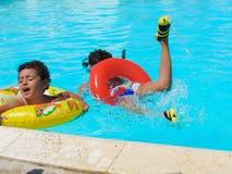 Kids at swimming Pool. Egypt, Nov. 23 2014 : Happy people and girls in bikini enjoying bath time in pool, Sharm el-Sheikh Stock Images
