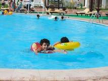 Kids in the Swimming Pool. Egypt, Nov. 23 2014 : Happy people and girls in bikini enjoying bath time in pool, Sharm el-Sheikh Royalty Free Stock Image