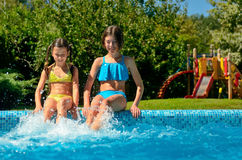 Kids in swimming pool have fun and splash in water Royalty Free Stock Photography