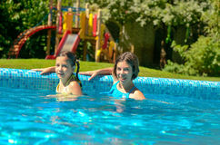 Kids in swimming pool have fun in water, children on family vacation Royalty Free Stock Photo