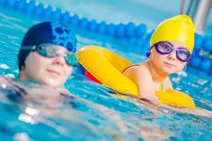 Kids in a Swimming Pool royalty free stock images