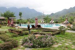 Kids with swimming pool landscape at Moc Chau, Viet Nam - April, 11, 2015 royalty free stock images