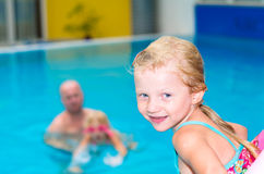 Kids in the swimming pool Stock Photography