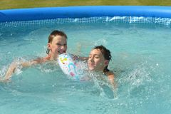 Kids swimming in pool Stock Images