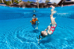 Kids  swimming underwater Stock Photos
