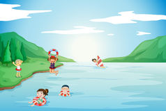 Kids swimming in water Stock Photography