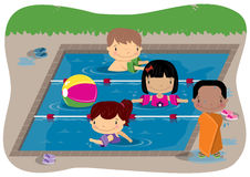 Kids Swimming. Young children in a swimming pool Royalty Free Stock Photo