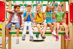 Kids on swing Stock Photography