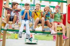 Kids on swing Stock Photos