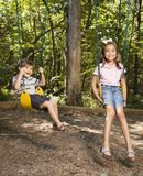 Kids on swing set. Hispanic boy and girl on swing set smiling at viewer Royalty Free Stock Photos