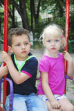Kids on swing Stock Image