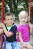 Kids on swing stock image