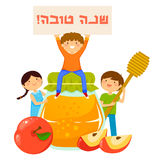 Kids with symbols of Rosh Hashanah. Kids with honey, apples and a sign that says Shana Tova Stock Images