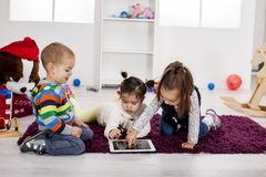 Kids with tablet royalty free stock photo
