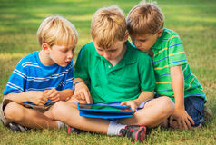 Kids with Tablet Computer Stock Photos