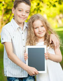 Kids with tablet pc outdoors Stock Images