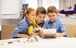 Kids with tablet pc programming at robotics school. Education, science, technology, children and people concept - group of happy kids or students with tablet pc Royalty Free Stock Photography
