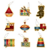 Kids tags. Bright gradient traditional childrens toys on tags Royalty Free Stock Photography