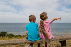 Kids taking a break. Young caucasian kids in Denmark on a summer day Royalty Free Stock Images