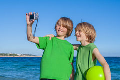 Kids taking selfie on holiday in Mallorca Spain stock photography