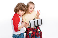 Kids taking selfie with smartphone Royalty Free Stock Image