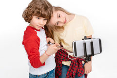 Kids taking selfie with smartphone Stock Photography